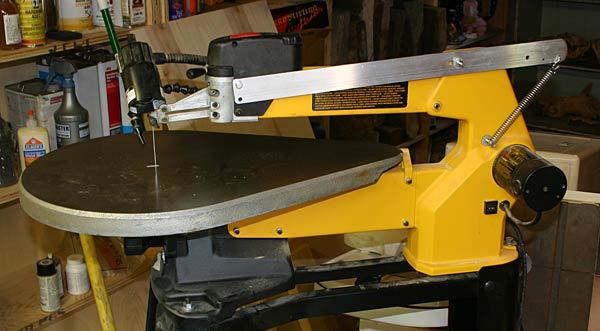 DeWalt scroll saw modified with a spring lever