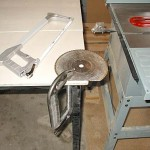 A big C clamp holds the blade tight to the table