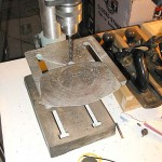 Drilling holes with a drill press to cut the hole for the handle