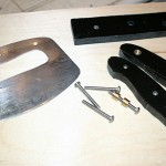 """Handle scales cut from phenolic material. Probably 3/8"""" Micarta or G10"""